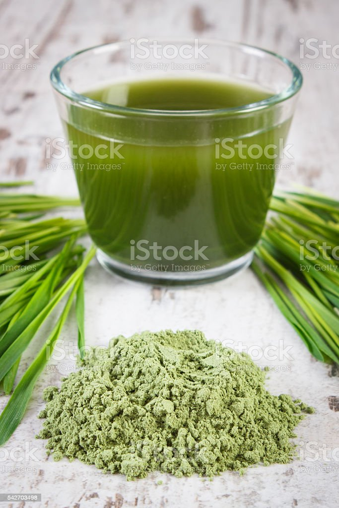 Heap of young powder barley, barley grass and beverage stock photo
