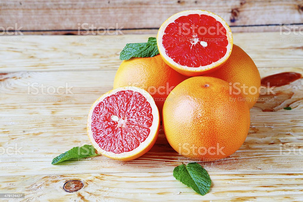 heap ripe grapefruit on a wooden background stock photo