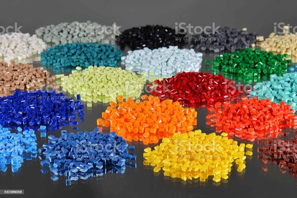 heaps of dyed polymer resin stock photo