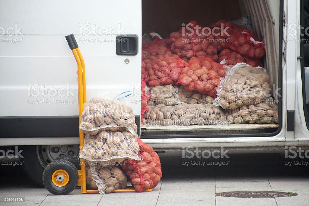 Heaps of potatoes sacks in the market. stock photo