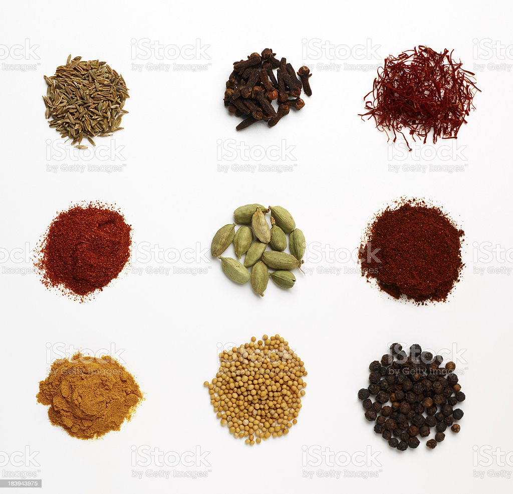 heaps of various spices on white background royalty-free stock photo