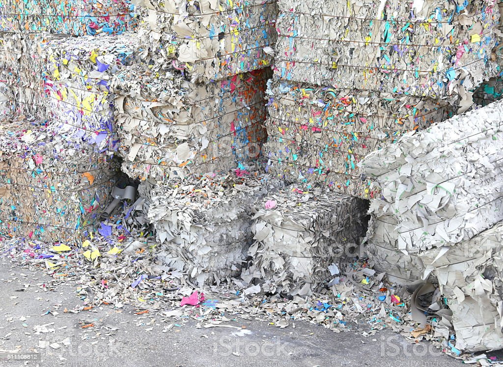 heaps of waste paper in the paper mill stock photo