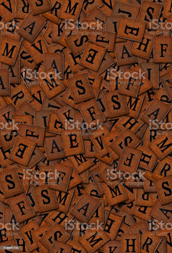 heaps of wooden letters stock photo