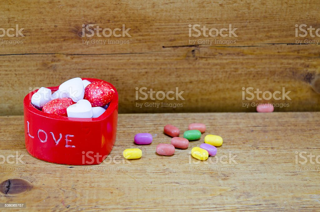 Hear shaped box filled with colorful candies royalty-free stock photo
