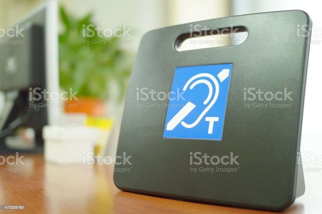 Hearing loop system on a desk stock photo