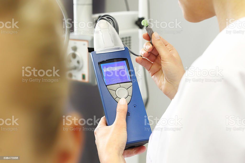 Hearing test. otolaryngologist doctor examining a patient. stock photo
