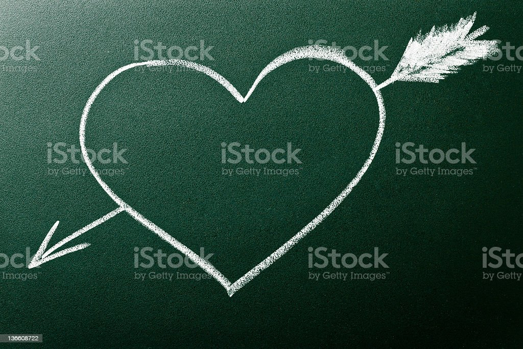 Heart and arrow as concept of Love At First Sight royalty-free stock photo