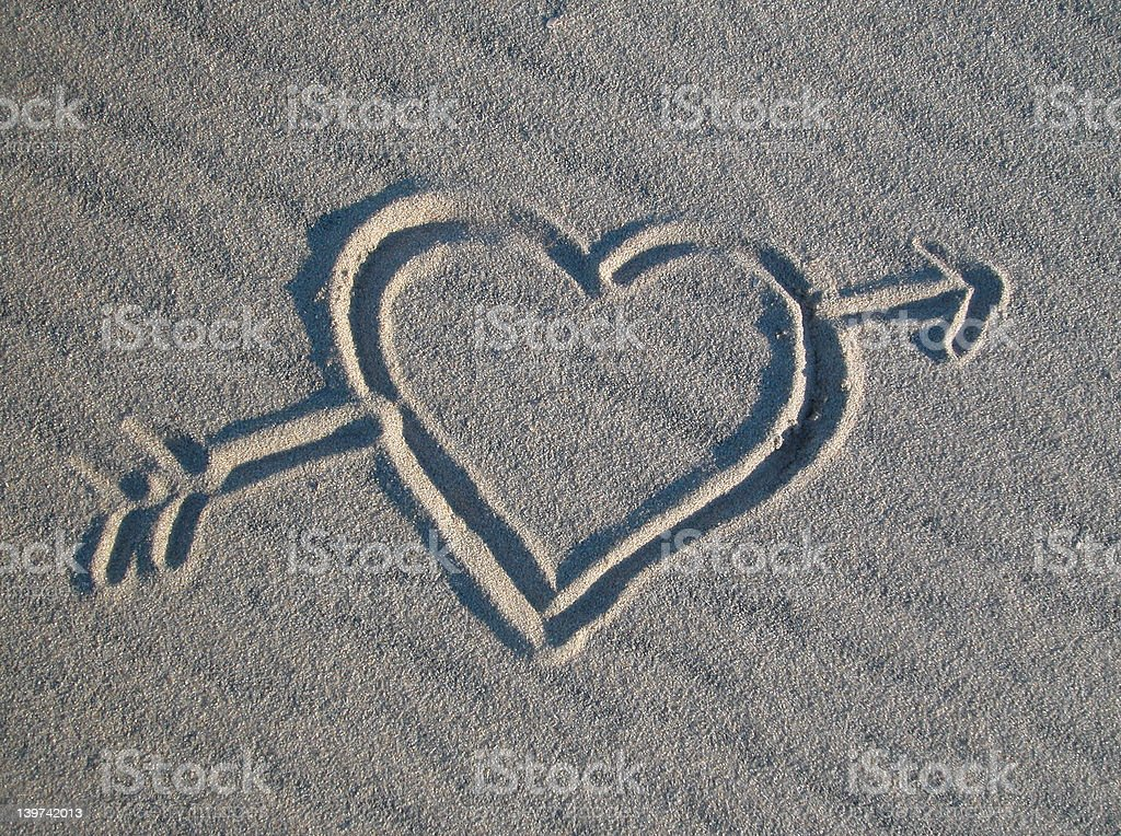 heart and arrow in sand royalty-free stock photo