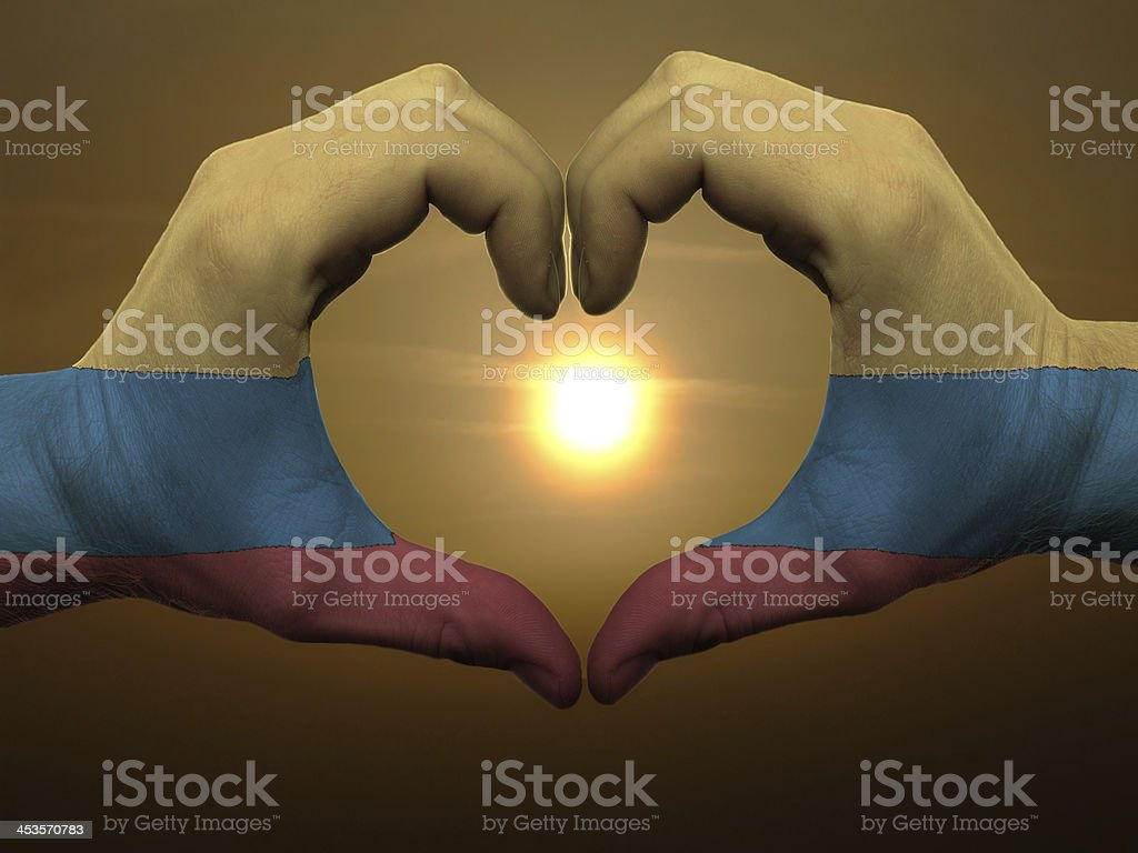 Heart and love gesture by hands colored in colombia flag royalty-free stock photo