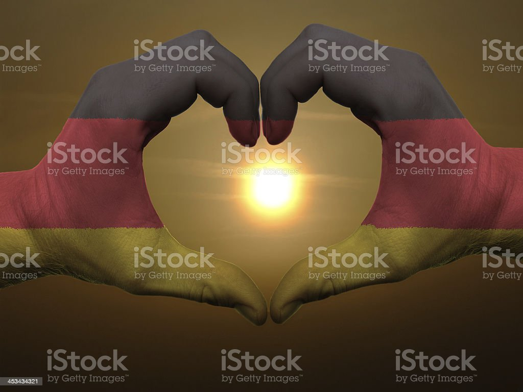 Heart and love gesture by hands colored in germany flag stock photo