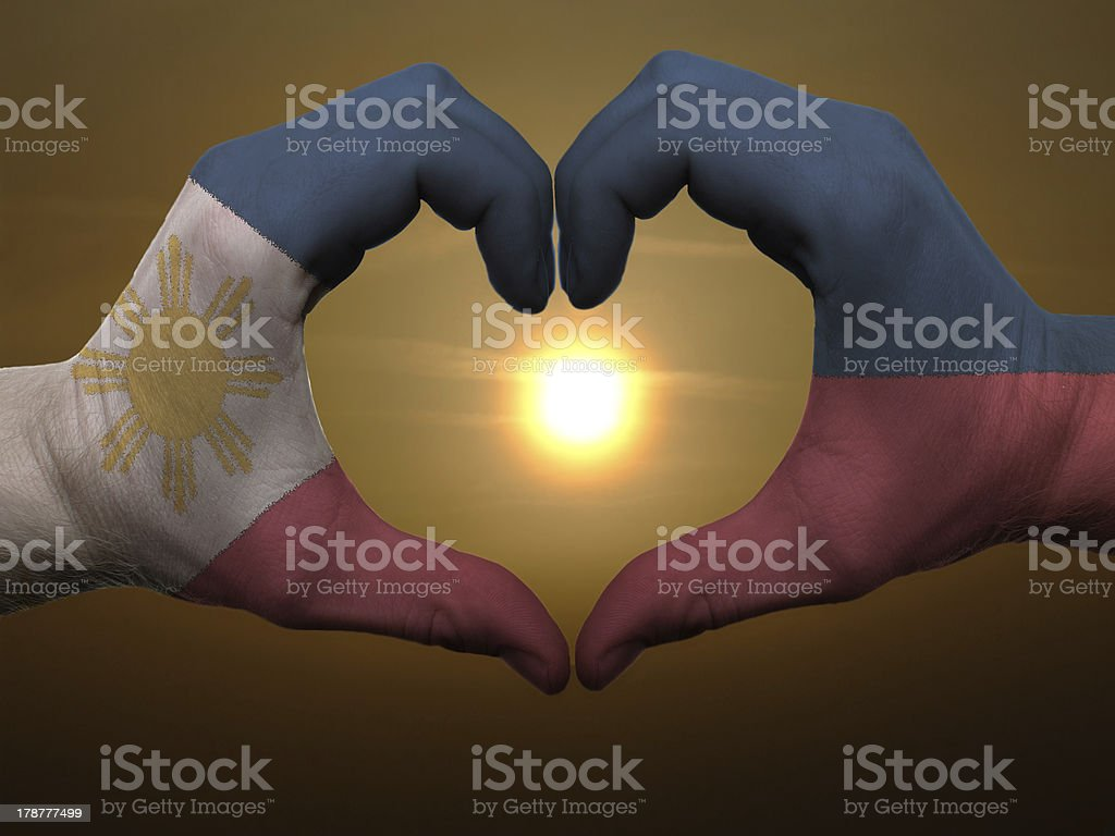 Heart and love gesture by hands colored in phillipines flag royalty-free stock photo