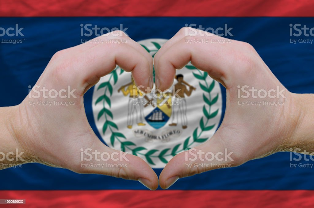 Heart and love gesture over flag of belize stock photo