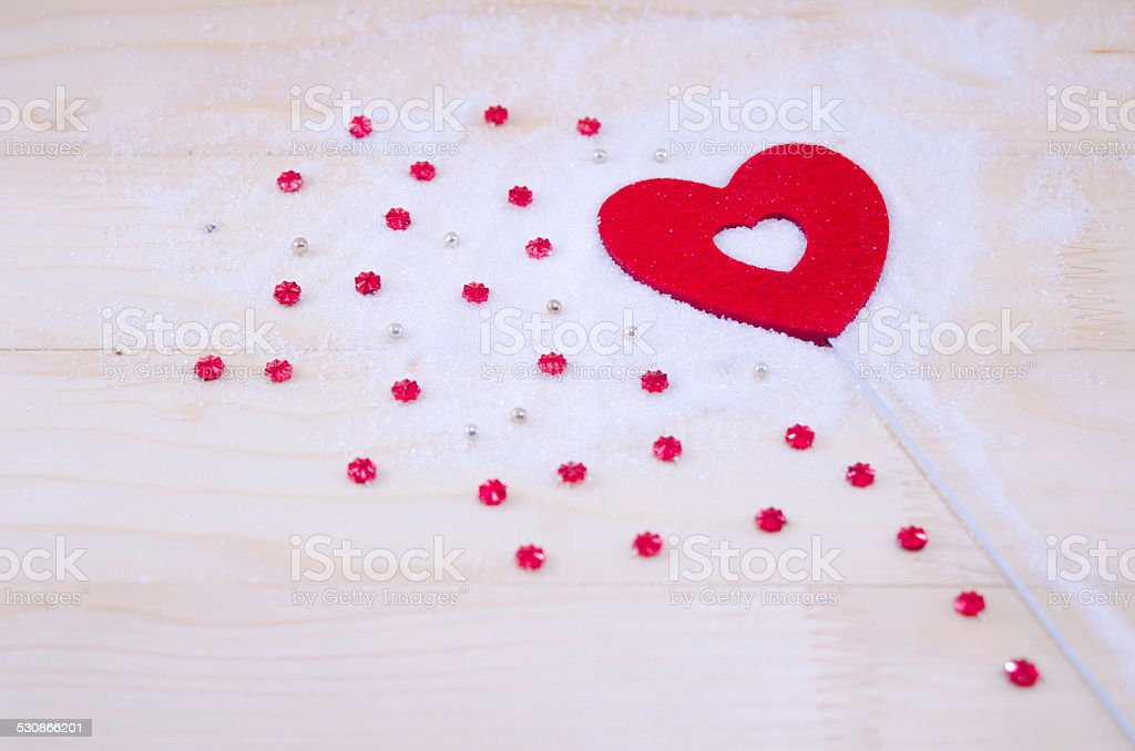 Heart and red stars on a wooden surface royalty-free stock photo
