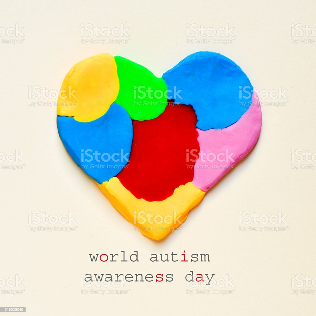 heart and text world autism awareness day stock photo