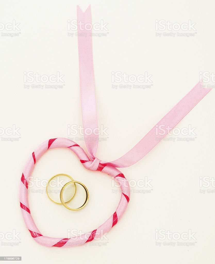 Heart and wedding rings stock photo