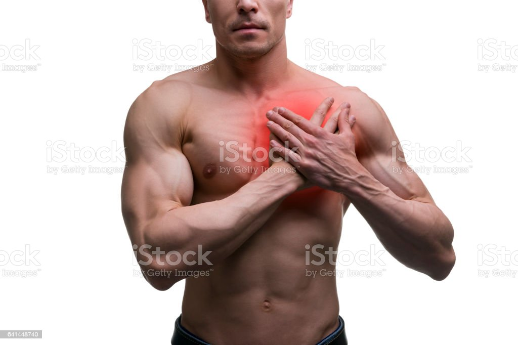 Heart attack, middle aged muscular man with chest pain stock photo