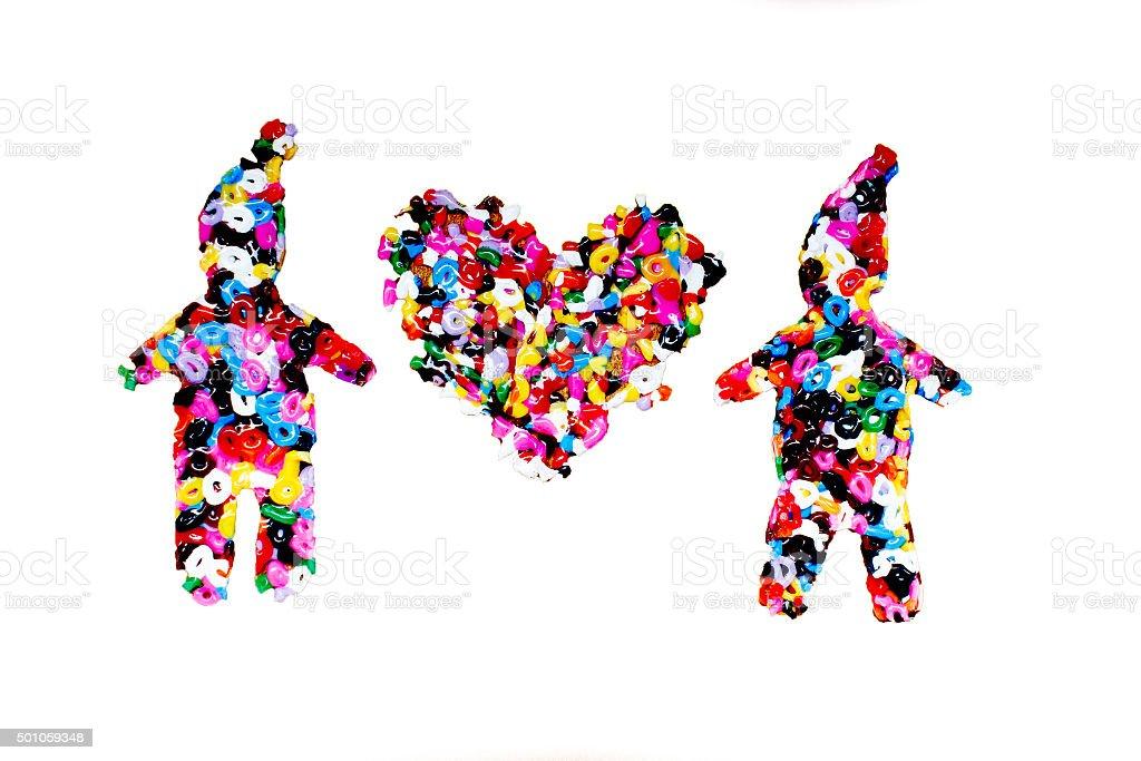 heart between figures of little men stock photo