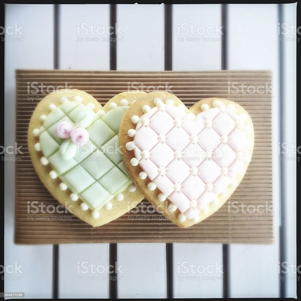 Heart biscuits on white table royalty-free stock photo