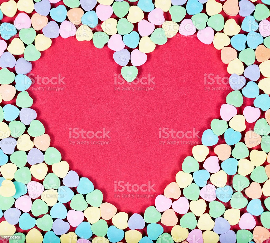 Heart blank space with colorful candies on outside stock photo