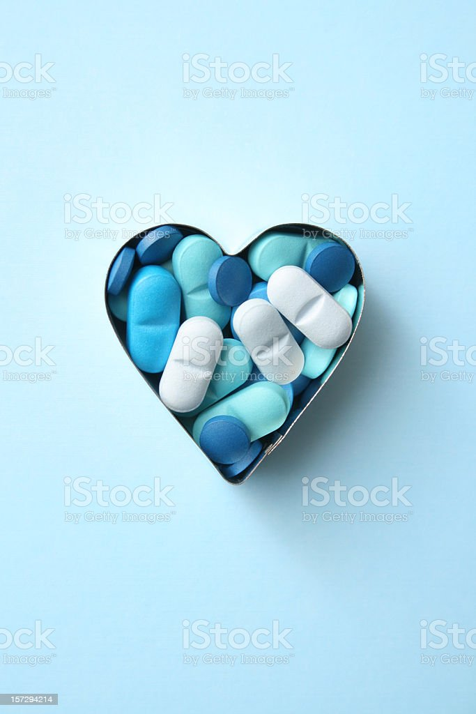 Heart blues pills stock photo