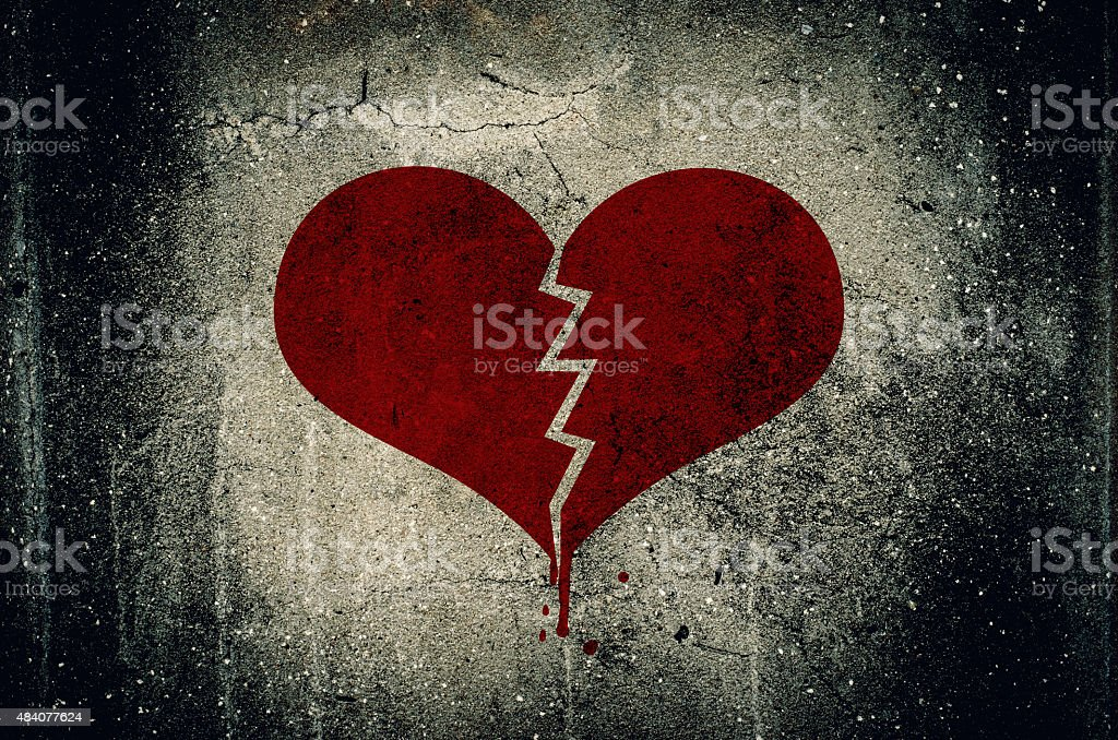 Heart broken painted on grunge cement wall background stock photo