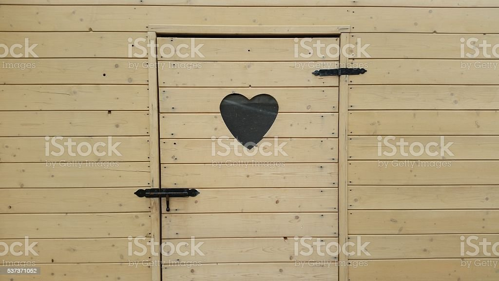 heart carved on the door stock photo