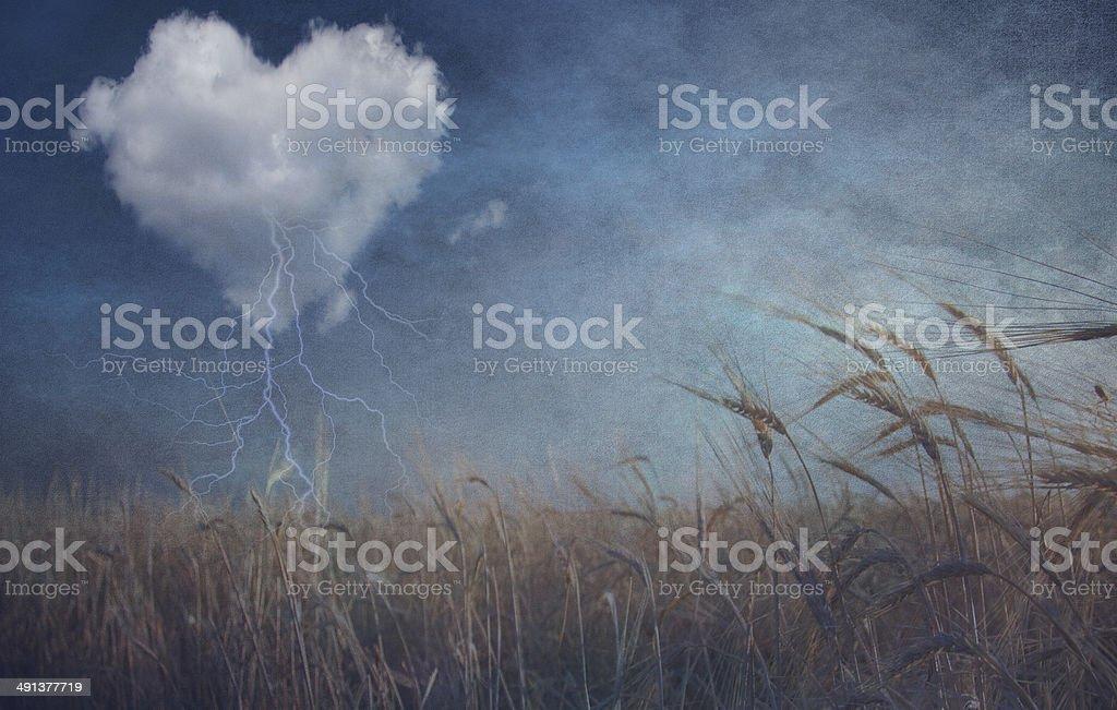 Heart cloud over field grunge textured stock photo