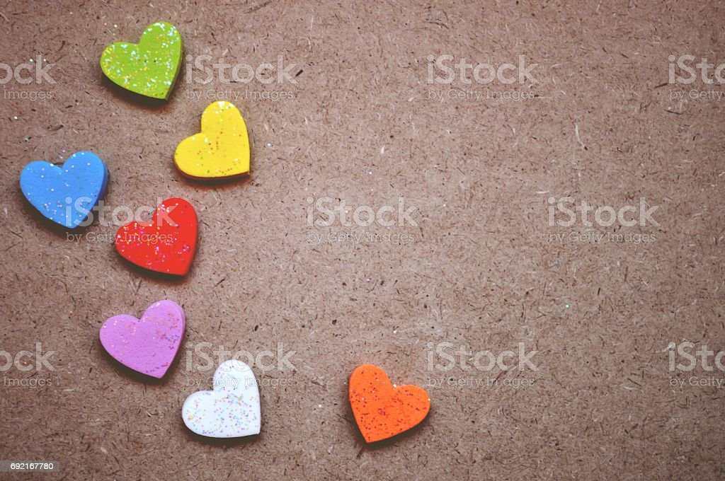 Heart colorful on wood background stock photo