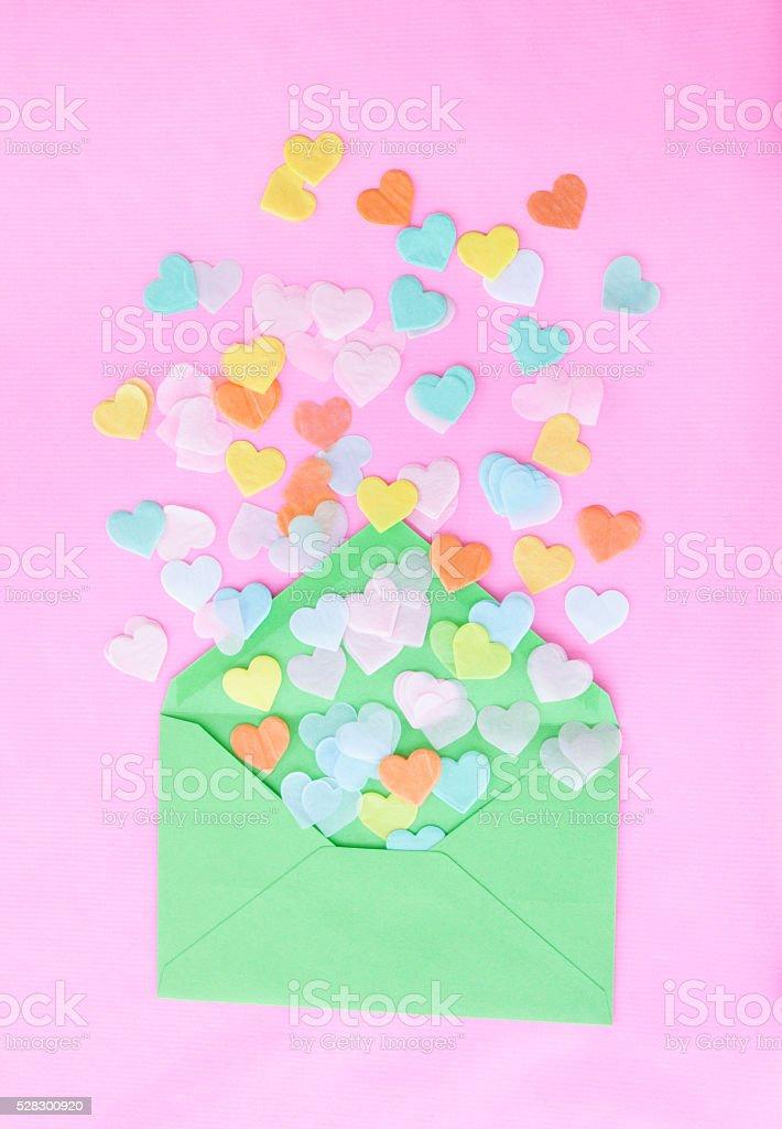 Heart confetti on pink stock photo