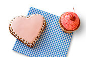 Heart cookie and pink cupcake.