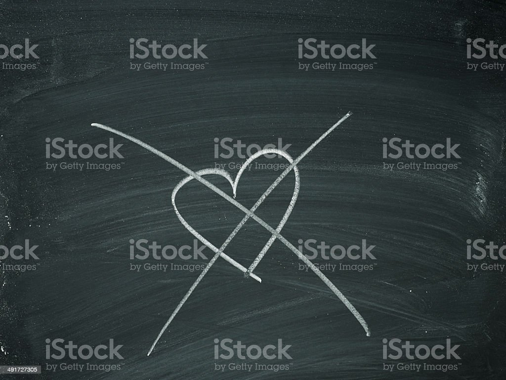 Heart crossed out chalk stock photo