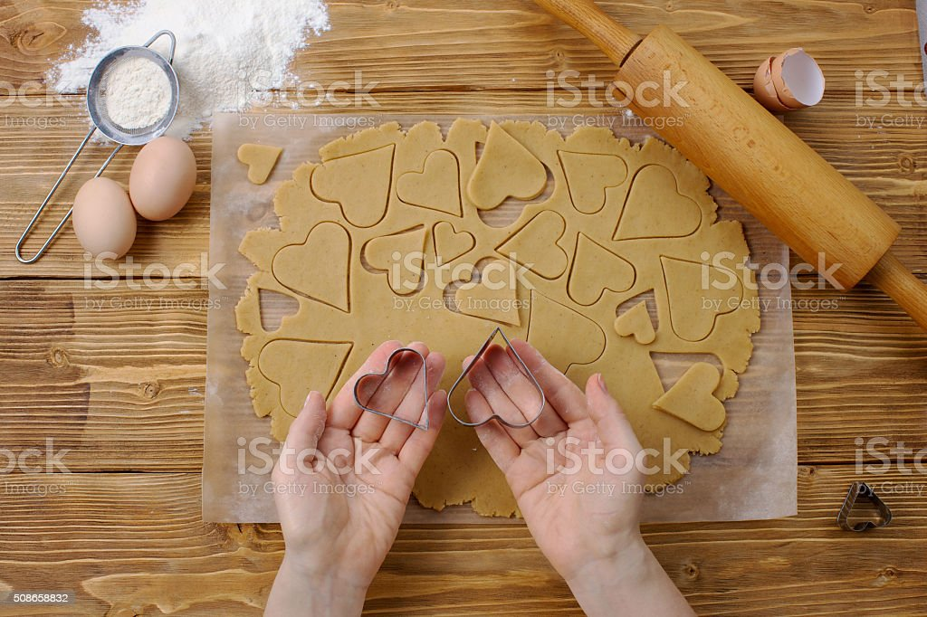 Heart cutters in the chief hands stock photo