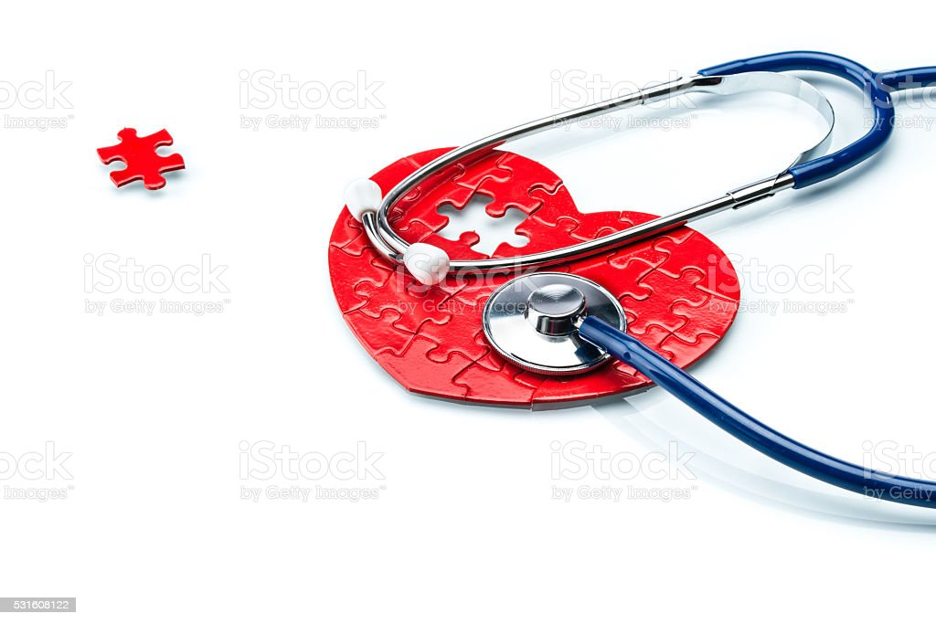 Heart disease, puzzle heart with stethoscope stock photo
