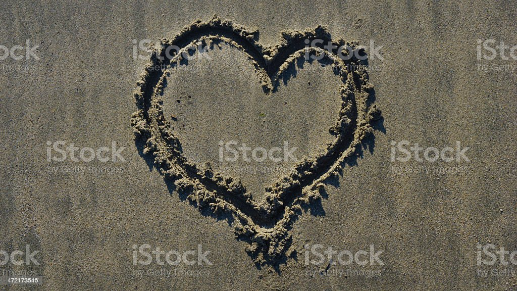 Heart draw on sand on a summer day stock photo