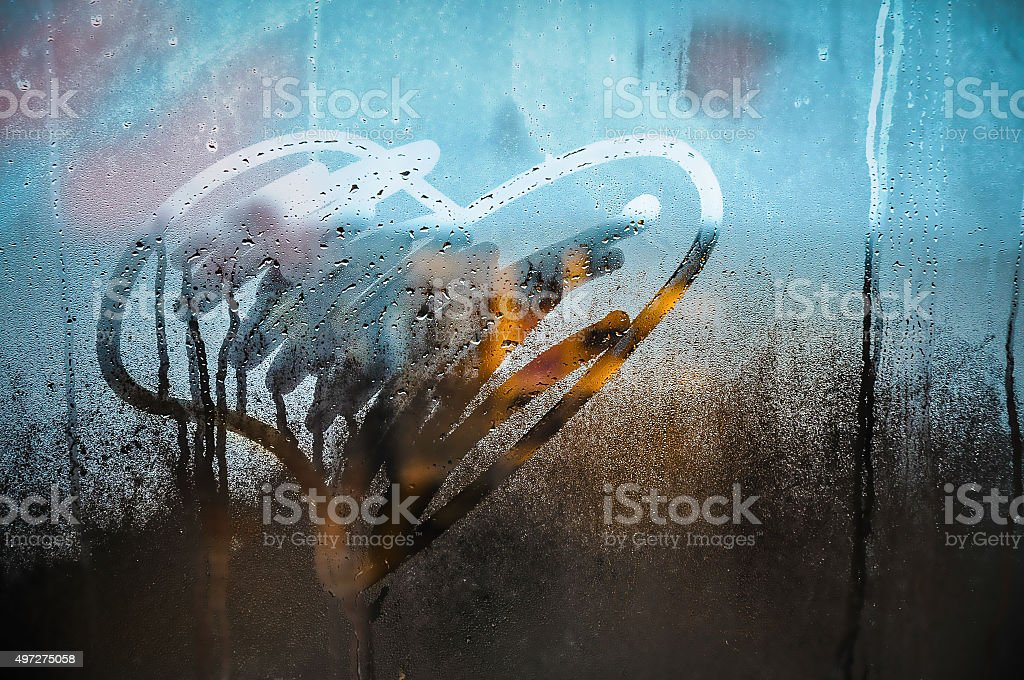 Heart drawing on window. stock photo