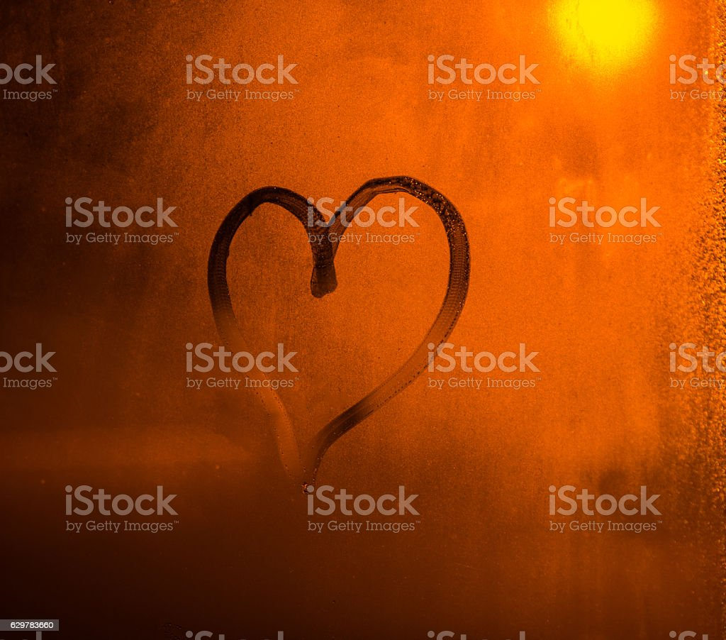 Heart Drawn by Hand on a Frosted Window, Valentines Background stock photo