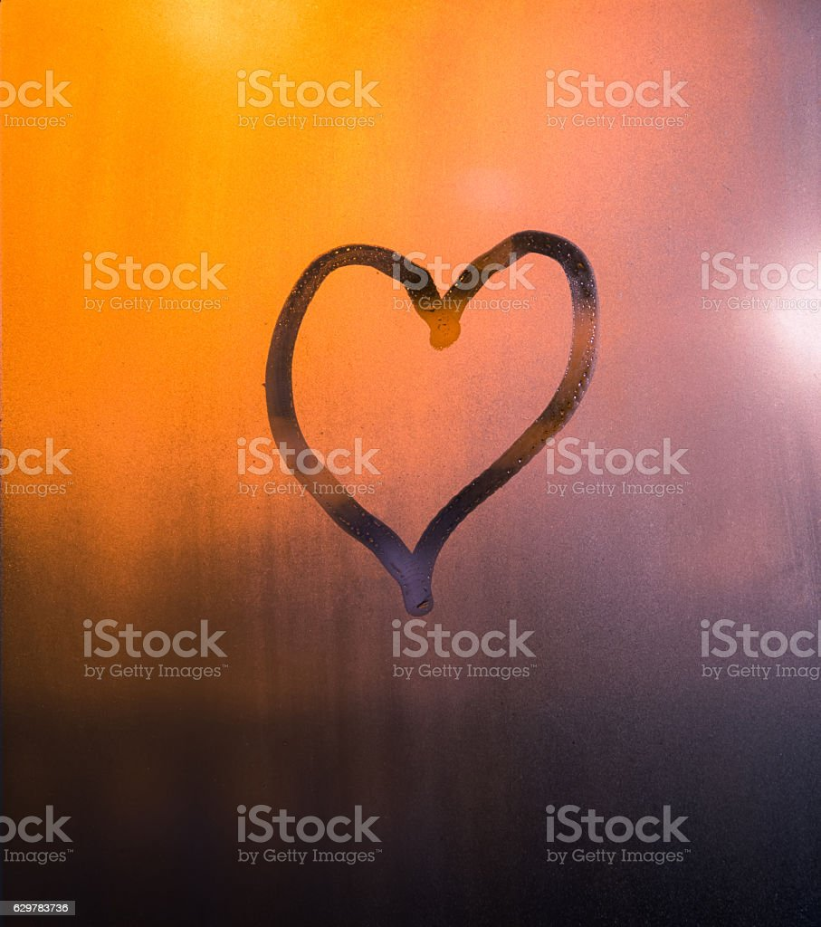Heart Drawn by Hand on the Window, Valentines Background stock photo