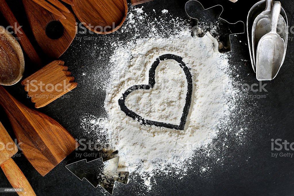 Heart Drawn in Baking Flour with Kitchen Supplies Border stock photo