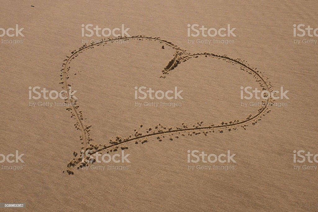 Heart drawn on sand. Horizontal composition. stock photo
