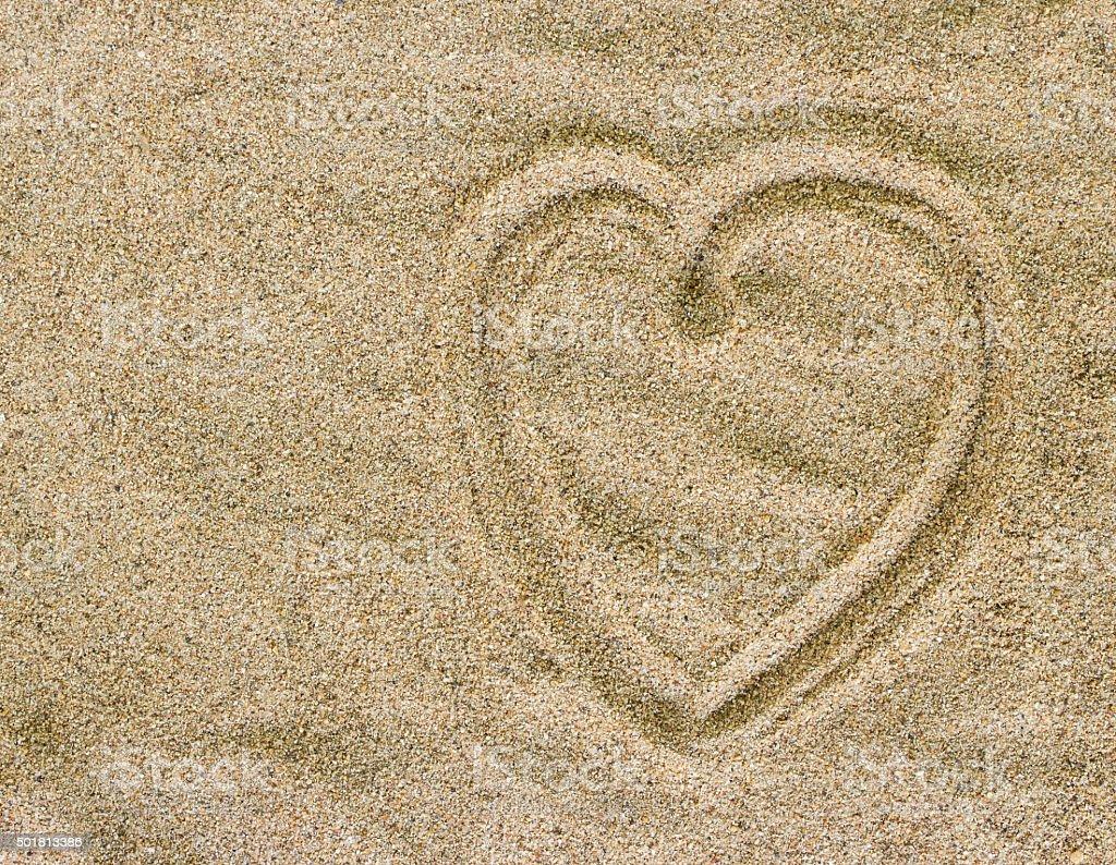 Heart drawn on sand stock photo