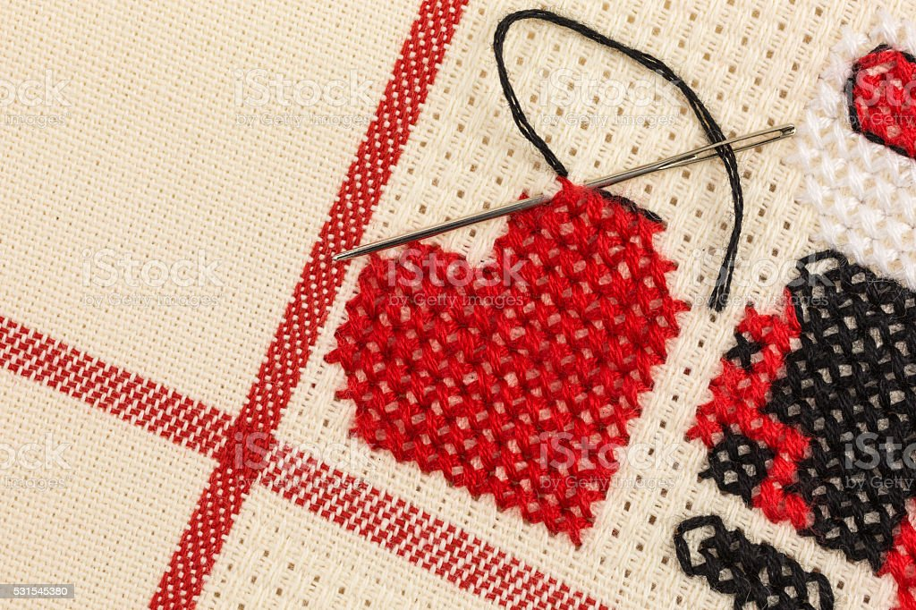 heart embroidered on canvas stock photo