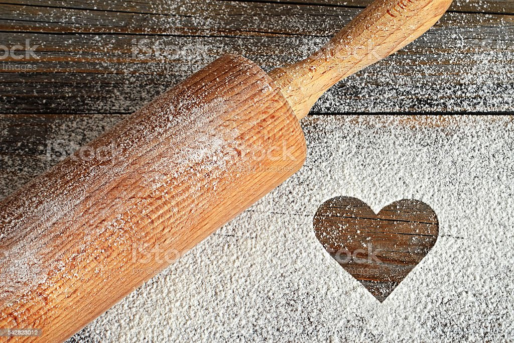 Heart, flour and rolling pin stock photo