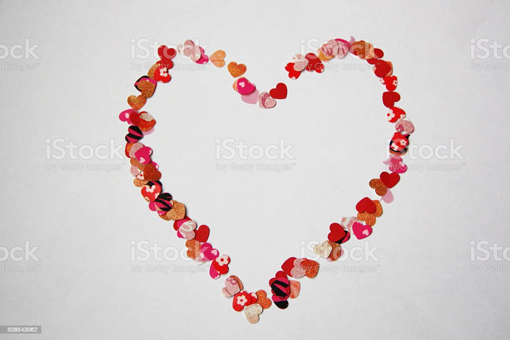 Heart frame of small love hearts on white background stock photo