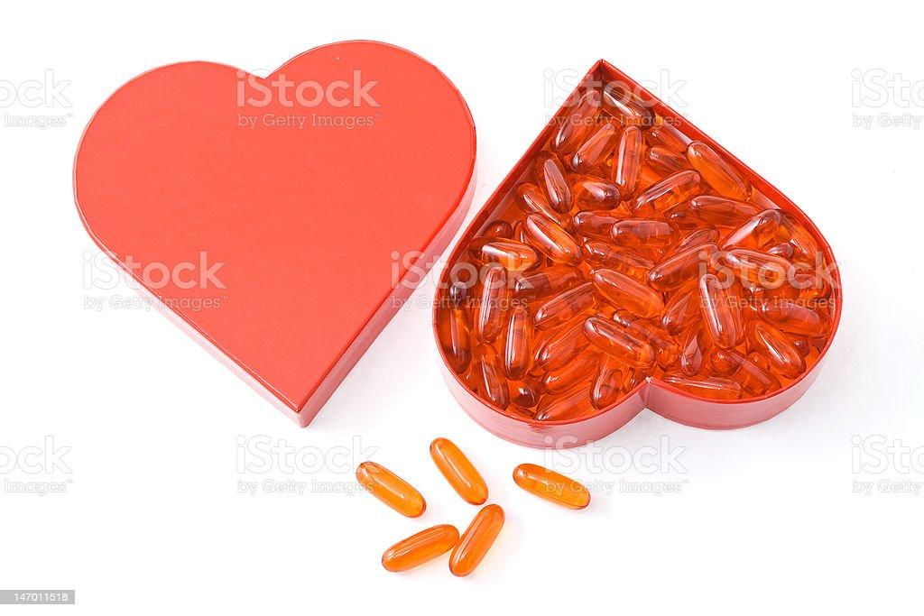 Heart friendly fish oil capsule royalty-free stock photo