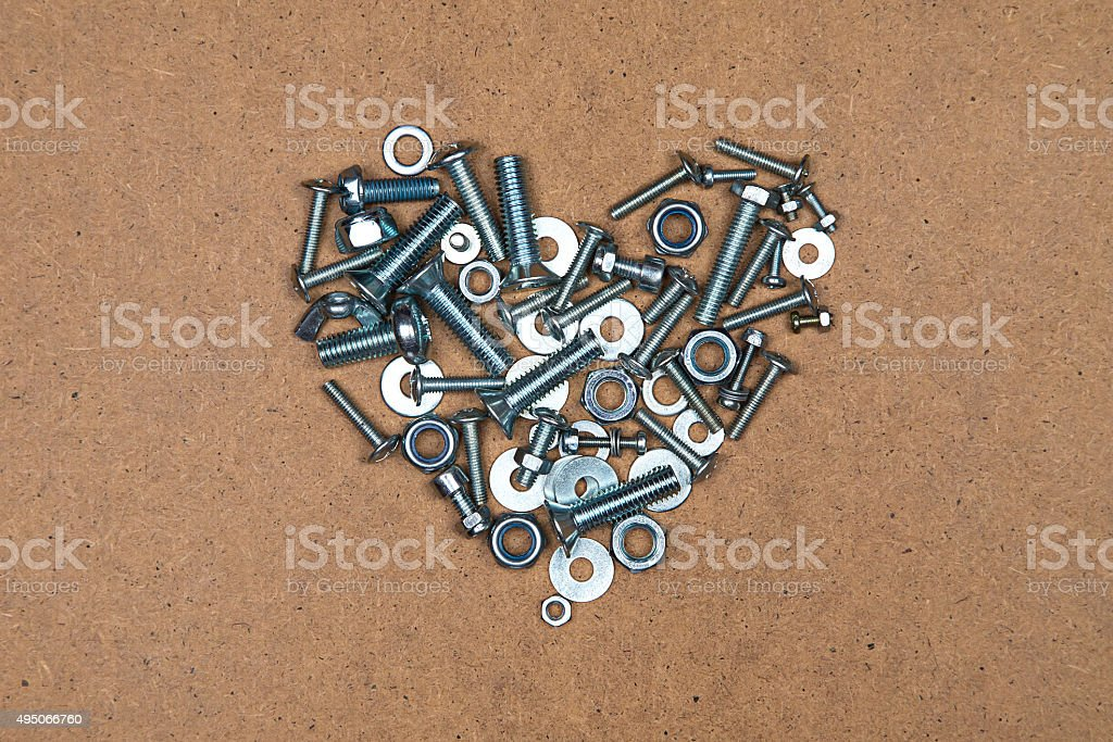 Heart from bolts and nuts stock photo