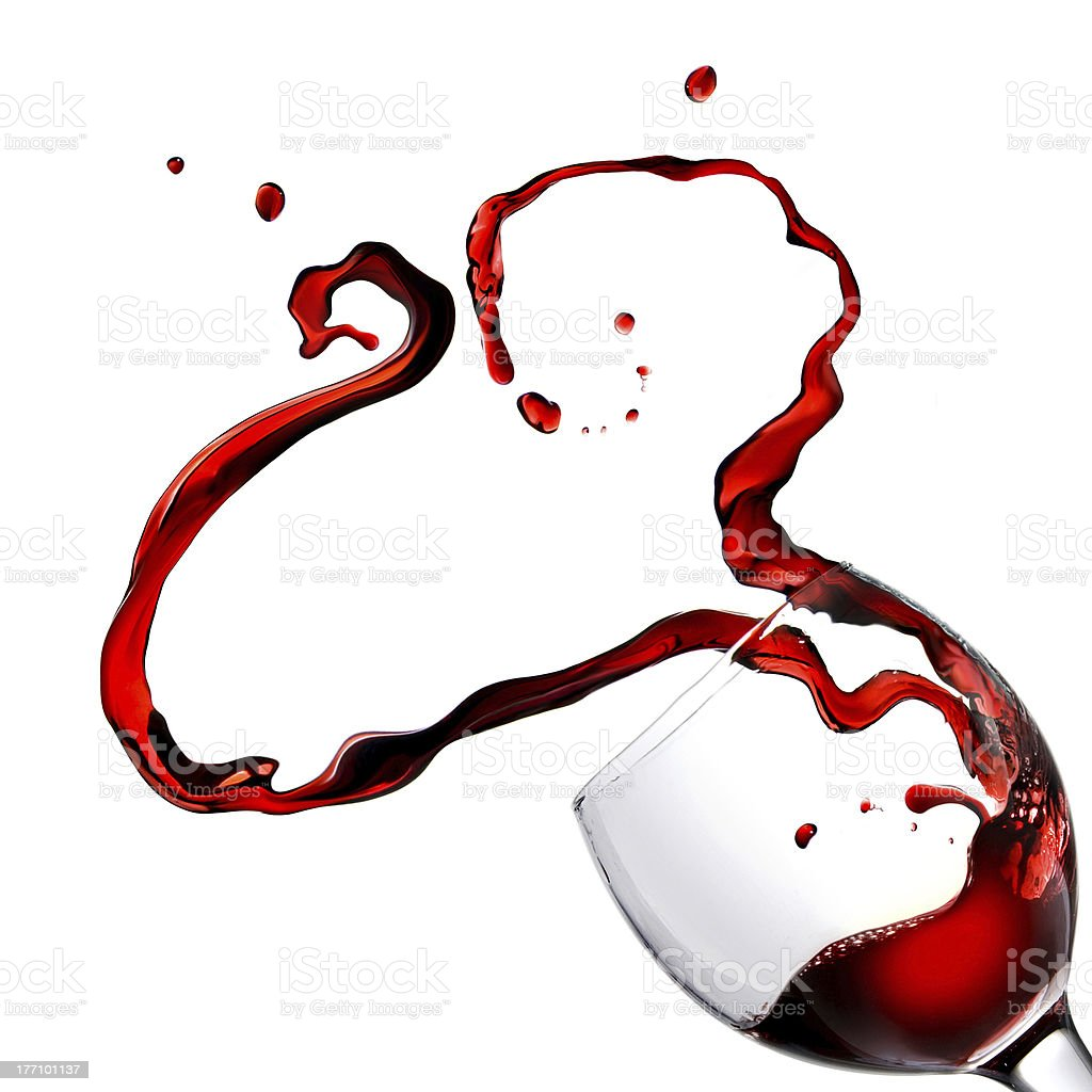 Heart from pouring red wine in goblet isolated on white royalty-free stock photo