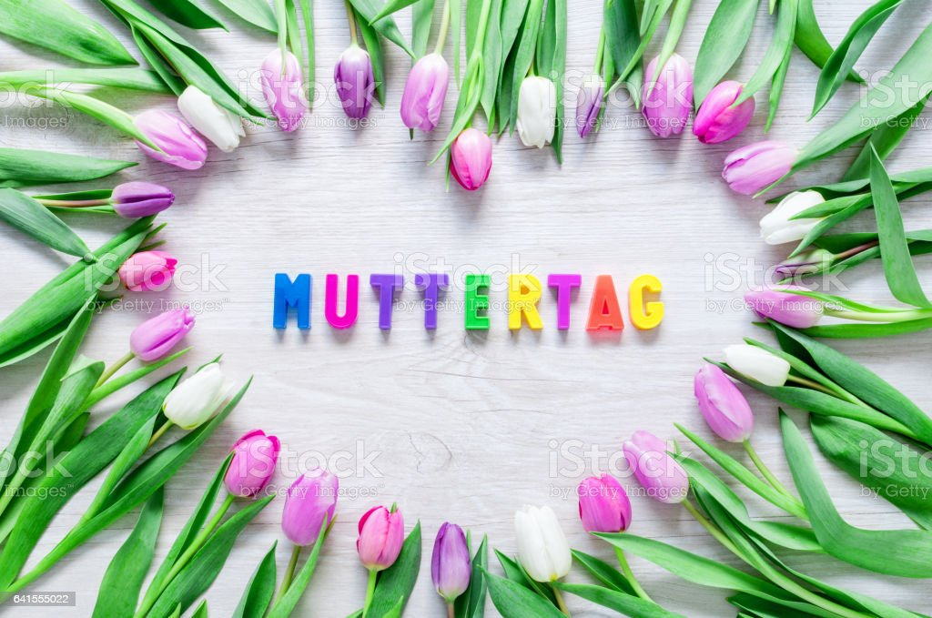 Heart from Tulips Flowers on rustic table for  Mothers day stock photo