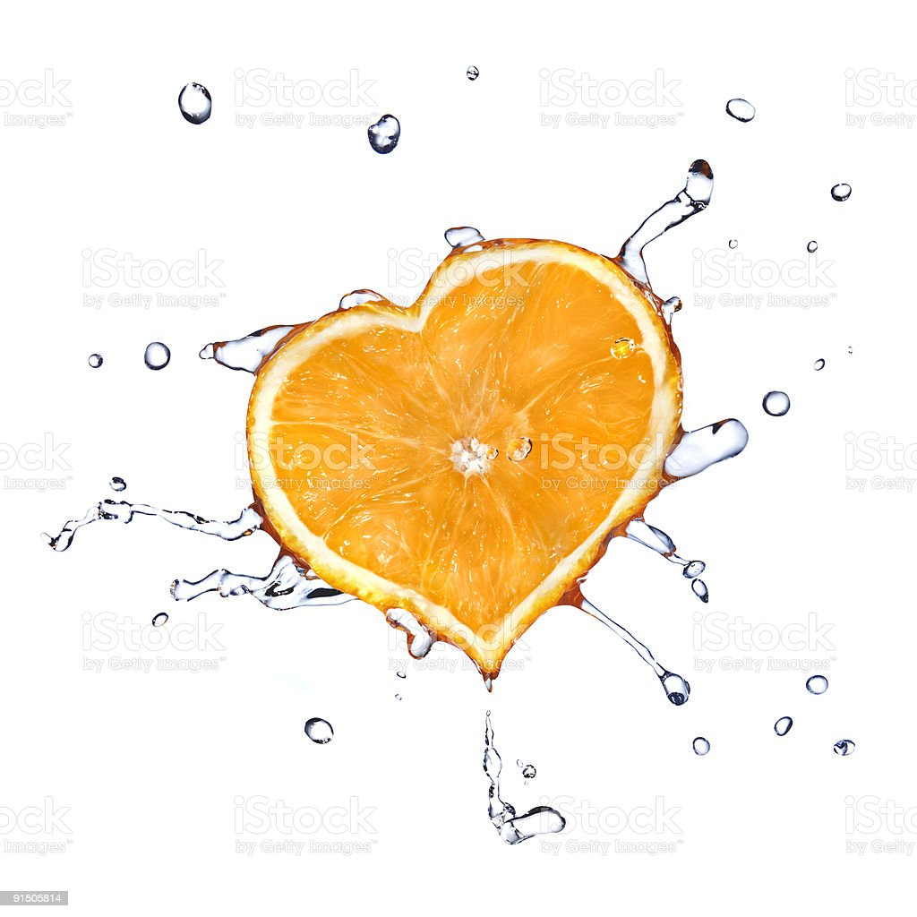 heart from water drops and orange isolated on white stock photo