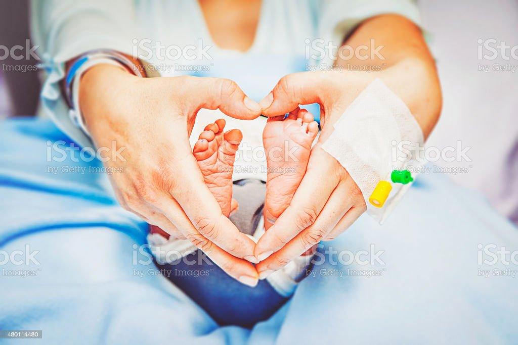 Heart Hands Feet stock photo
