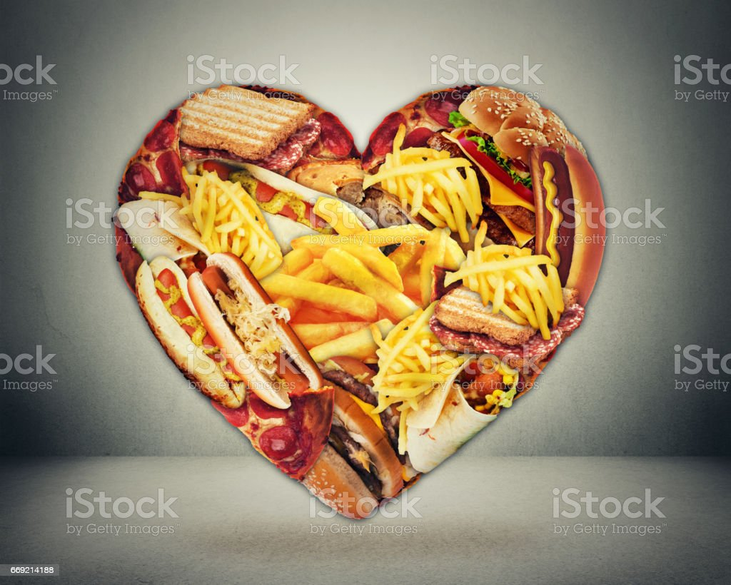 Heart health and bad diet stroke risk concept. Heart shaped of fast junk fatty food stock photo